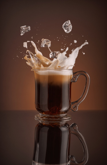 An iced cappuccino with splashing ice